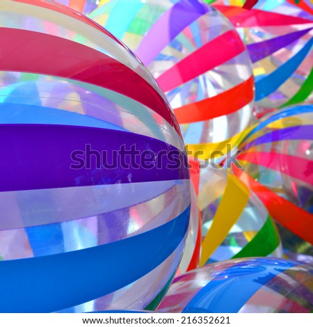 Background or texture: Colorful striped balloons create an abstract suggesting a festive mood. - stock photo