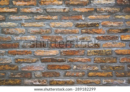 Background pattern of weathered old brick wall texture, toned grungy rusty brushed blocks as urban architecture backdrop. - stock photo