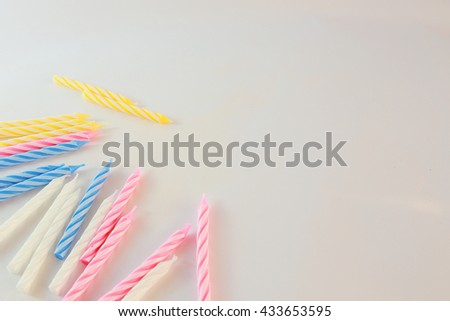 Background picture of  Variety of birthday candles in a row. Copy space. - stock photo