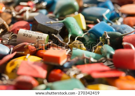 Background pile of old capacitors with led bulbs, which use colorful. - stock photo