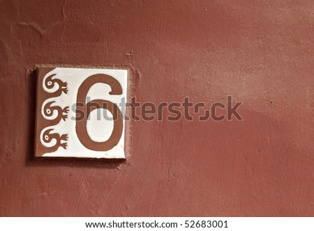 Background resources: A number 6 tile with Maya symbol on red background