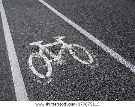 Background resources: White cycling path signal on grey background in diagonal