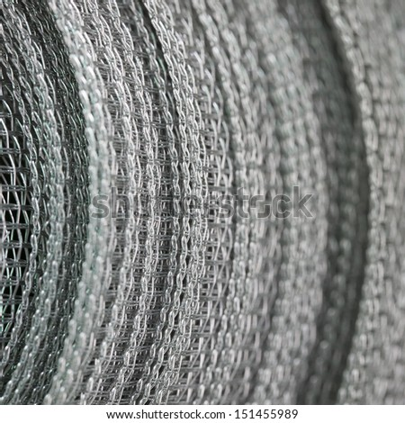 Background. Roll of a metal grid close up.  - stock photo
