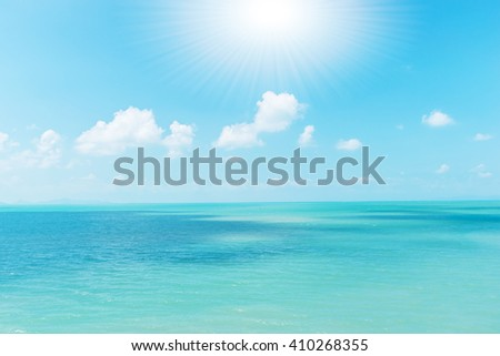 Background sea blue sky with white clouds.