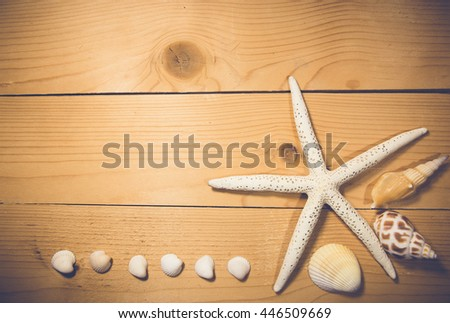 Background starfish on wood - stock photo