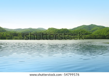 Background summer mountains landscape with blue waters and clear sky - stock photo