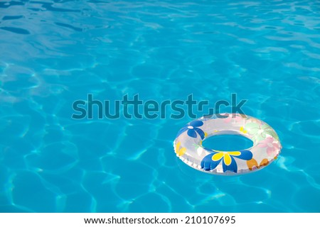 Background summer pool image shot. Buoy floating on the pool water.