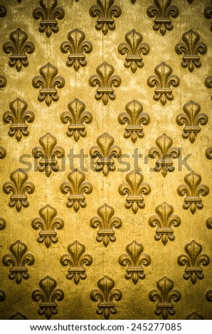 Background Texture Of A Regal, Gold Fleur-de-lis Coat-Of-Arms On Napoleon's Tomb In Paris, France - stock photo