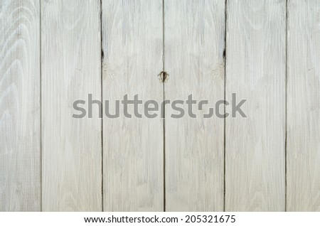 Background texture of a weathered old planked wood fence, lightly painted in off-white. - stock photo