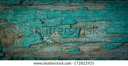 Background texture of an old weathered grungy wooden wall with cracked and peeling blue paint and vignetting around the edges - stock photo
