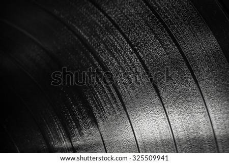 Background texture of black vinyl record, selective focus shallow DOF - stock photo