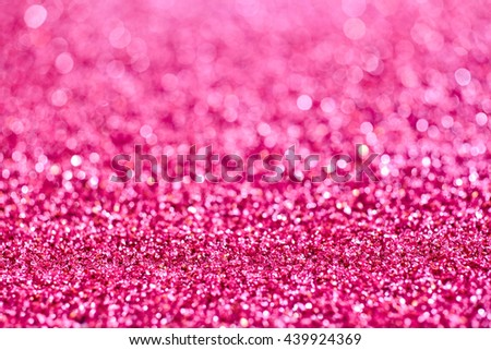 Background texture of colorful sparkling pink glitter for craft work or as a decoration for a festive occasion or Christmas holiday celebration, full frame shallow dof view - stock photo