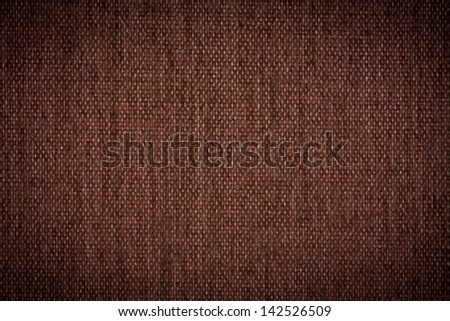 Background texture of dark brown fabric closeup with vignette - stock photo