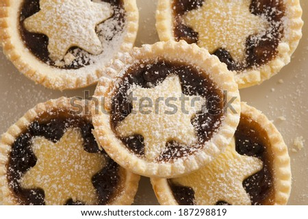 Background texture of decorative Christmas mince pies with crisp golden crusts and pastry stars for a traditional seasonal treat - stock photo