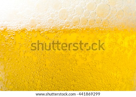 Background  texture of frosty beer with foam and bubbles - stock photo