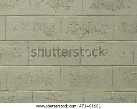 Background texture of light yellow paint concrete block wall