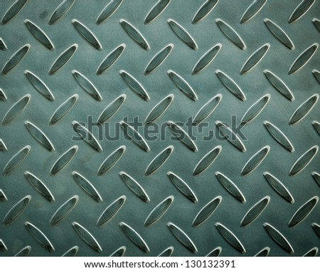 Background texture of metal diamond plate - stock photo