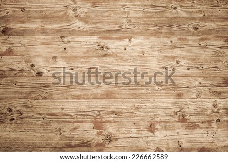 Background texture of natural brown uncolored wooden wall - stock photo