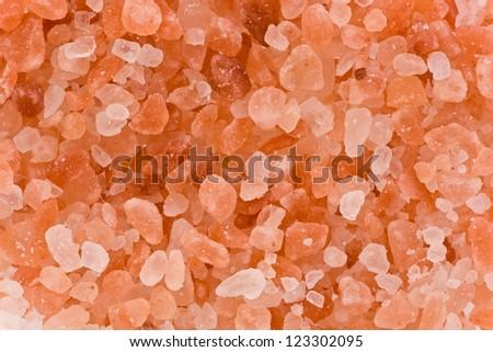 Background texture of natural Himalayan pink rock salt. - stock photo
