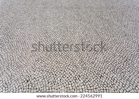 Background texture of typical portuguese walkway pavement - stock photo