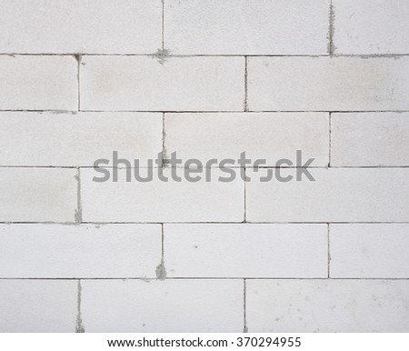 background texture of white Lightweight Concrete block, Foamed concrete block, raw material for industrial wall or house wall - stock photo