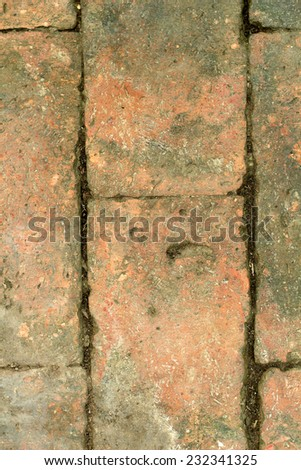 Background texture old brick weathered a long time.
