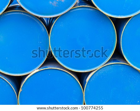 Background texture pattern of stacked blue metal petroleum drums. - stock photo