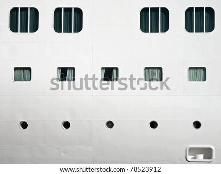 Background texture photo of white ship's hull with windows and illuminators - stock photo