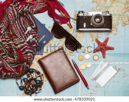 background - what to take for a trip. passport, phone, documents, car keys, map, camera, money, sunglasses, credit cards