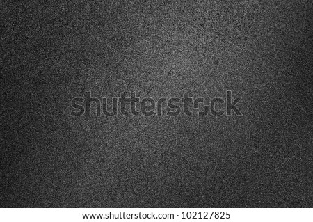 Background which look like asphalt, black background with spotlight - stock photo