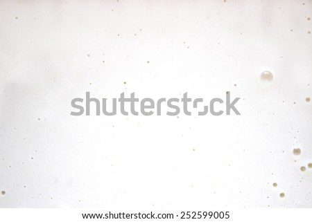 background white milk batter with bubbles - stock photo