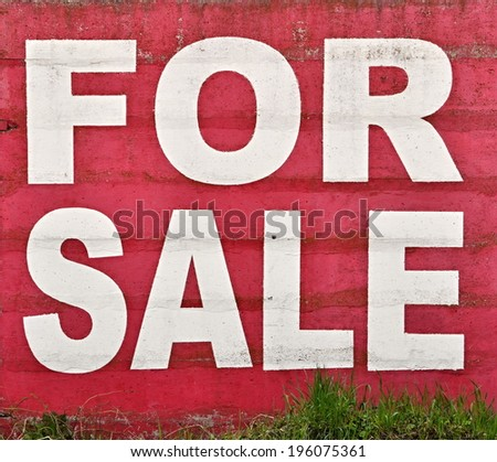 background white sign on red concrete for sale