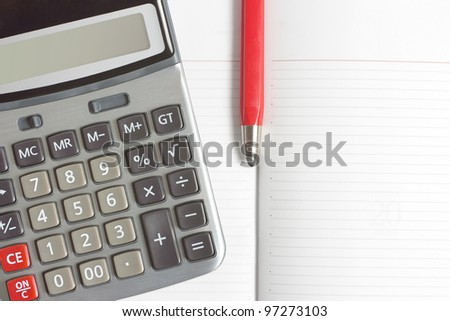 background with a calculator, red pen and diary - stock photo
