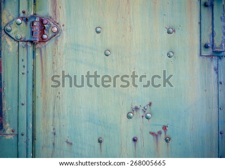 Background with a Faded blue-green chipped paint and hinge - stock photo