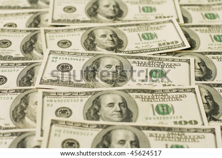 background with a lot of dollars - stock photo