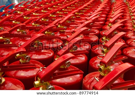 Background with a lot of fire extinguishers - stock photo
