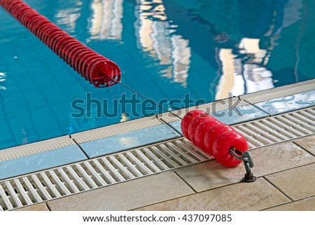 Background with a swimming pool and red markers between lanes competition. - stock photo