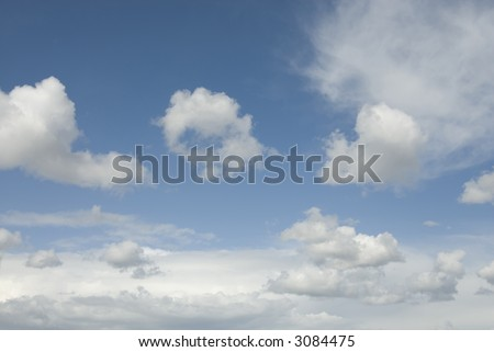 Background with blue sky with white cumulus clouds - stock photo