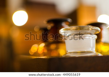 Background with brown and white antique glass bottles in wooden box
