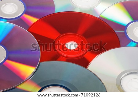 Background with CD / DVD disks - stock photo