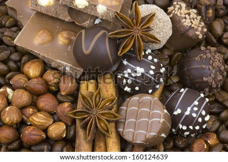 background with chocolate, coffee, spices and nuts - stock photo