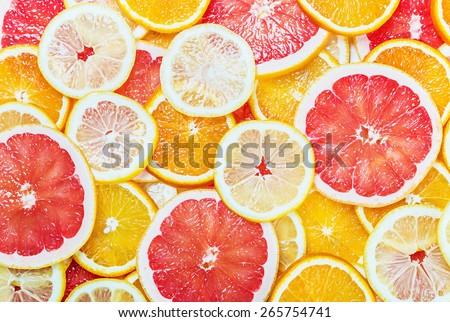 background with citrus-fruit of Fresh fruit slices - stock photo