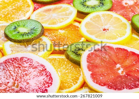 background with citrus-fruit of Fresh fruit slices. focus in the middle of the frame, shallow depth of field - stock photo
