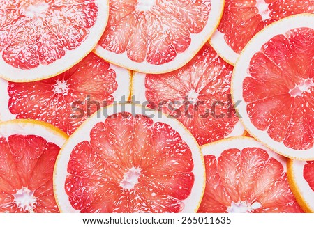 background with citrus-fruit of grapefruit slices - stock photo
