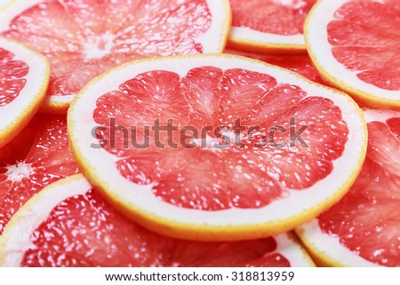 background with citrus-fruit of grapefruit slices. focus in the middle of the frame - stock photo