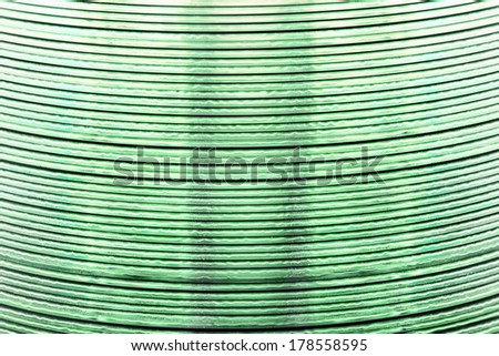 background with closeup of pile of cds - stock photo