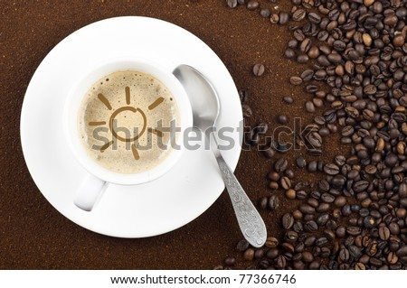 Background with coffee beans and grounded coffee in composition with a cup of coffee with a sun drawing in the middle. - stock photo
