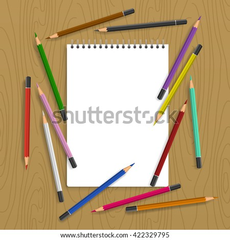 Background with color pencils. Empty notebook with and color pencil around on the table - stock photo