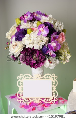 Background with colorful flowers in vase, and empty tag for text . Place for text. - stock photo
