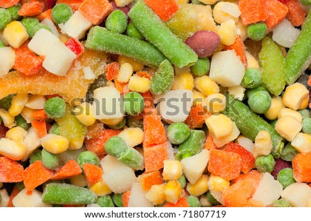 Background with colorful frozen vegetables - stock photo